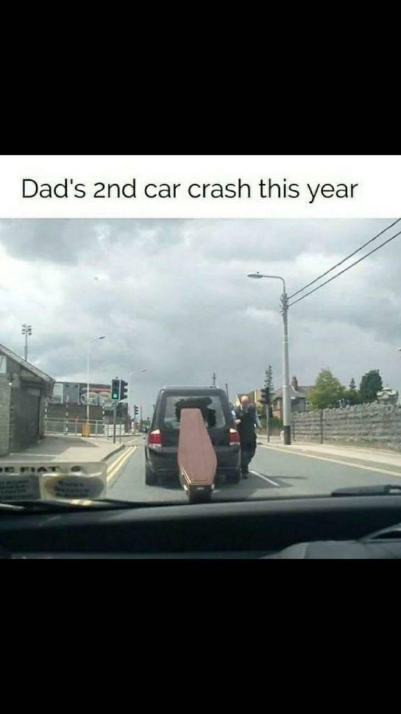 A coffin falling out of the backwindow of a funeral car.